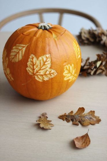 A-pumpkin-with-carved-leaves-is-a-beautiful-all-natural-fall-decoration-you-can-make-yourself