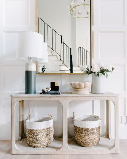 A-simple-wooden-console-table-and-two-matching-baskets-for-storage-are-very-comfy-and-give-a-cozy-feel-to-the-space
