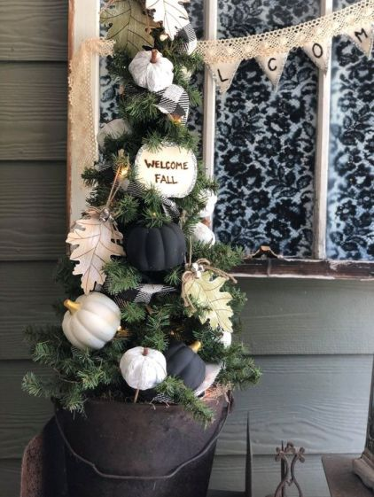 A-small-fall-tree-with-white-and-black-pumpkins-paper-leaves-a-plaid-ribbon-and-some-lights-can-fit-thanksgiving-too