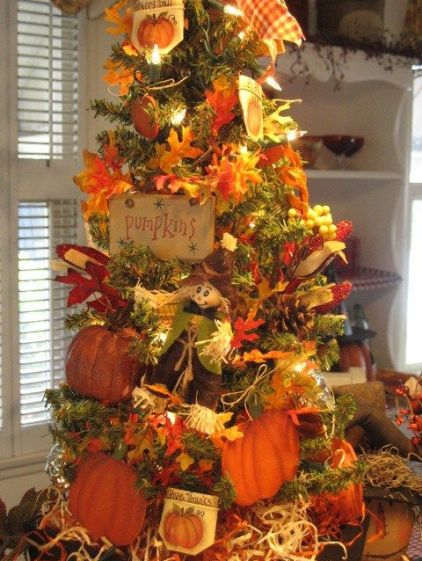 A-vintage-inspired-fall-tree-with-lights-faux-leaves-paper-pumpkins-pinecones-berries-and-plaid-decor