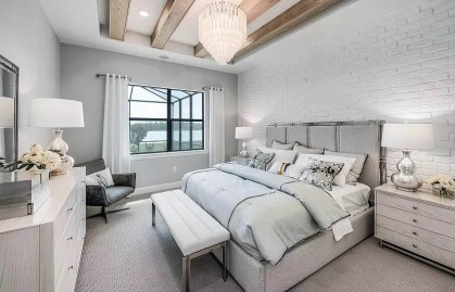 Bedroom-with-tray-ceiling-and-faux-wood-beams