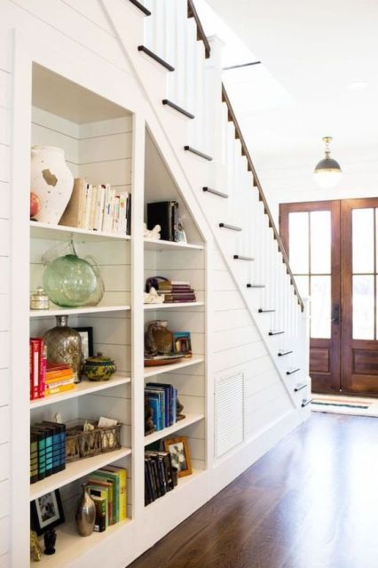 Built-in-open-shelves-under-the-stairs-are-nice-to-get-more-storage-space-without-sacrificing-floor-space