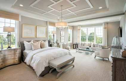 Master-bedroom-with-geometric-design-tray-ceiling-with-drum-chandelier