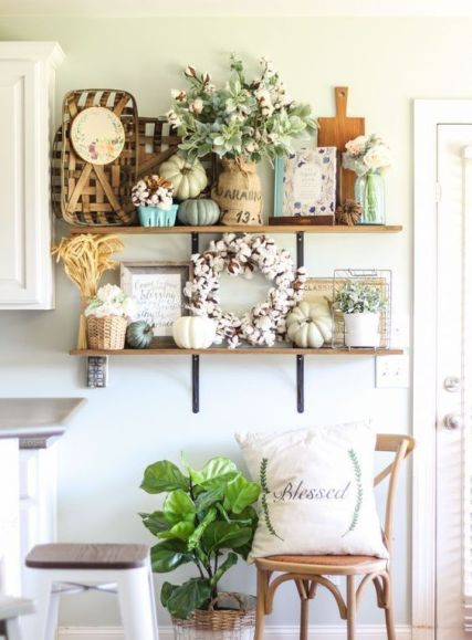Neutral-fall-pumpkin-a-cotton-wreath-blooms-in-vases-potted-greenery-and-a-wheat-arrangement-for-a-fall-kitchen
