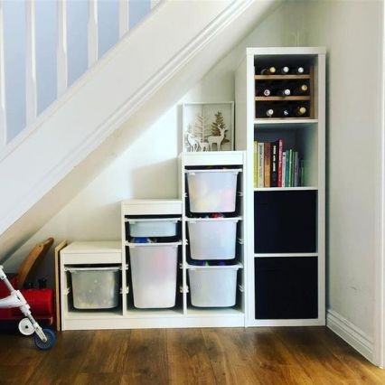 Place-an-ikea-kallax-shelving-unit-under-the-stairs-to-get-much-storage-space-without-any-effort