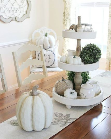 Some-fake-neutral-pumpkins-greenery-balls-and-a-printed-runner-will-bring-a-slight-fall-feel-to-the-space