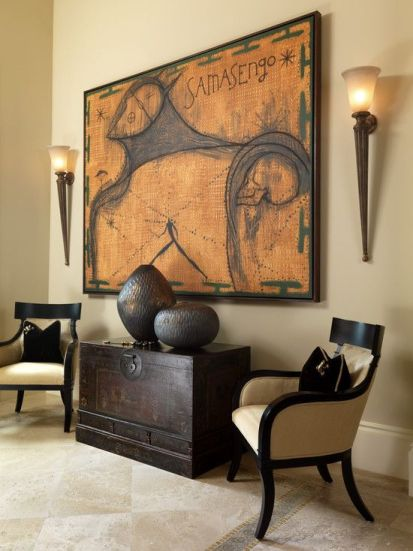 05-warm-colour-palette-and-dark-espresso-furnishings-and-decor-with-2-torch-wall-sconces-flanking-a-large-art-work
