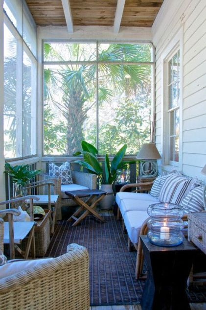 1-a-pretty-tropical-screened-porch-with-wicker-furniture-printed-pillows-potted-plants-candle-lanterns-and-lamps-is-cool