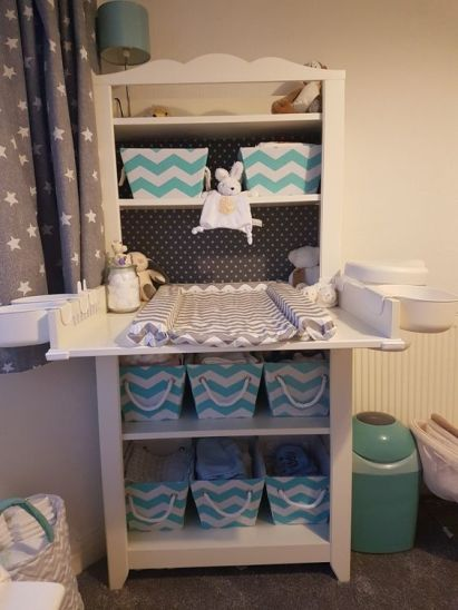 14-a-comfy-changing-table-with-fabric-crates-to-store-diapers-and-other-things