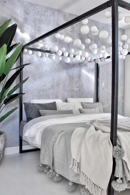 18-a-black-canopy-bed-with-white-bulb-garlands-over-it-is-a-fun-idea-to-add-light-without-any-lamps-around
