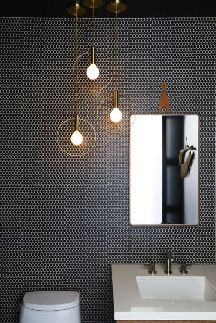 An-arrangement-of-brass-pendant-lamps-of-bulbs-and-circles-looks-super-refined-and-chic
