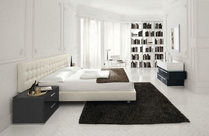 Sleek-white-bedroom-with-dark-colored-rug-for-contrast