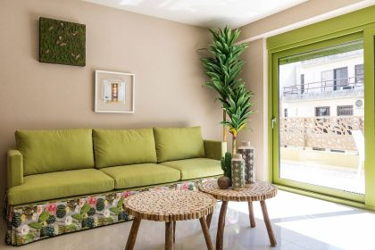 Giving-the-small-living-room-color-using-pops-of-green