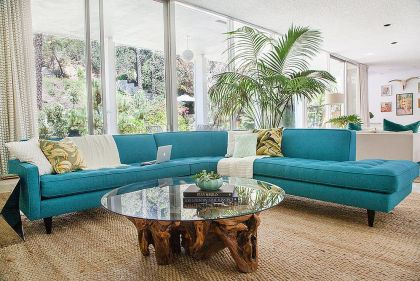 Midcentury-family-room-with-striking-couch-in-turquoise-and-a-cool-coffee-table