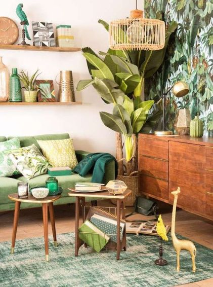 A-colorful-tropical-living-room-with-a-tropical-leaf-wall-a-green-sofa-wooden-furniture-woven-and-rattan-elements