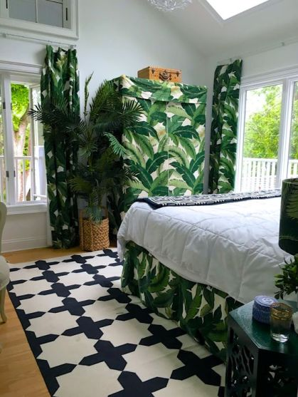 A-crazy-tropical-bedroom-done-in-a-monochromatic-color-scheme-and-spruced-up-with-tropical-prints-woven-touches-and-skylights