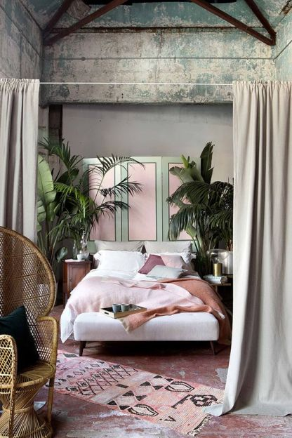 A-unique-tropical-bedroom-with-a-shabby-chic-ceiling-a-bed-and-a-bench-wooden-nightstands-and-a-peacock-chair-plus-tropical-plants
