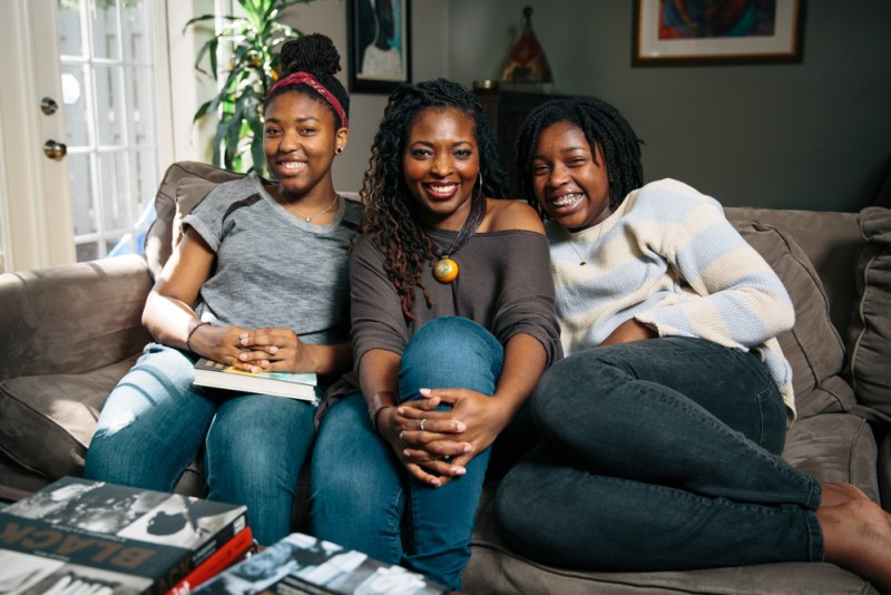 Millner with her daughters on a couch
