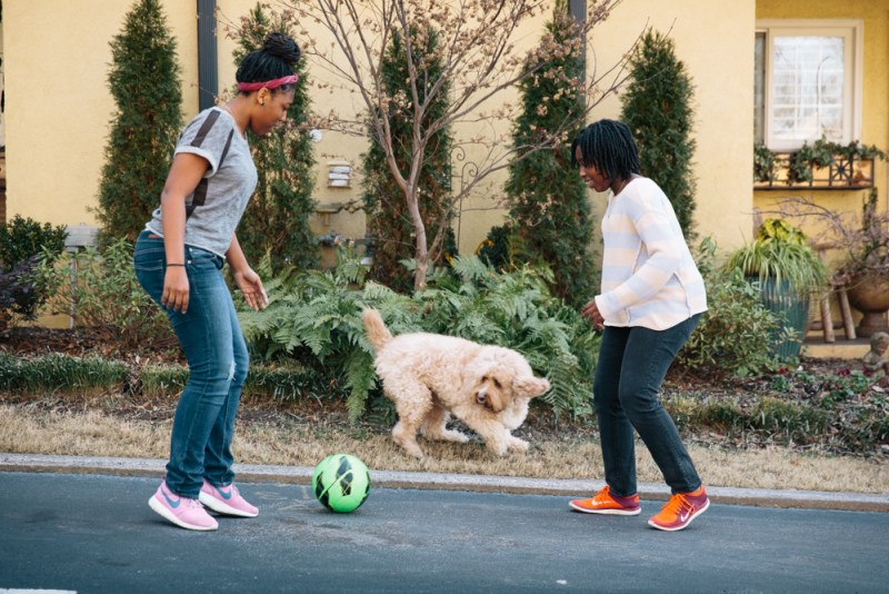 Denene Millner's daughters playing soccer with their dog