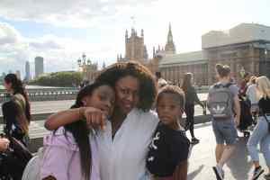 Bessie Akuba with her two children on London Bridge