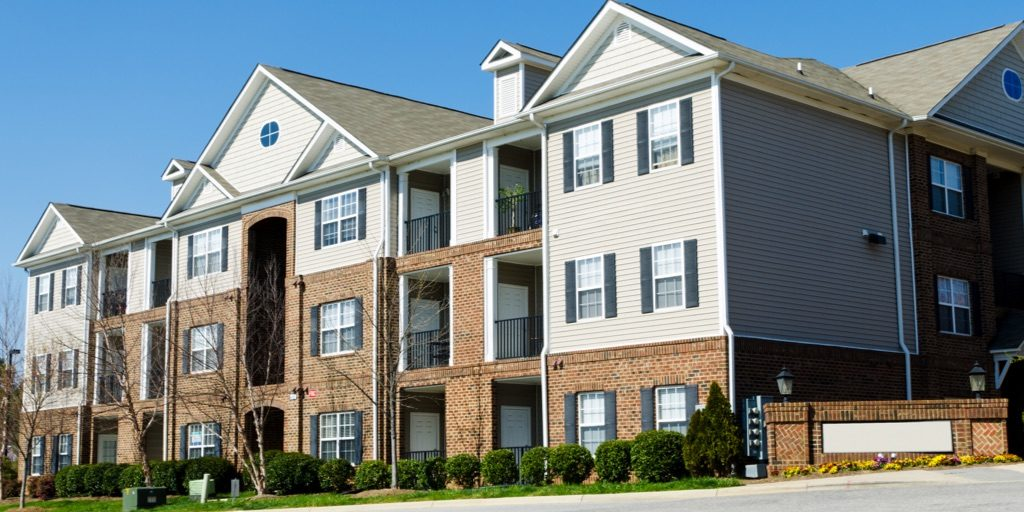 apartment complex depicting property management company sharing success stories