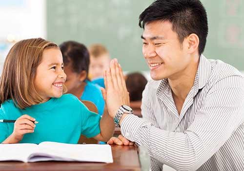 teacher and student high five