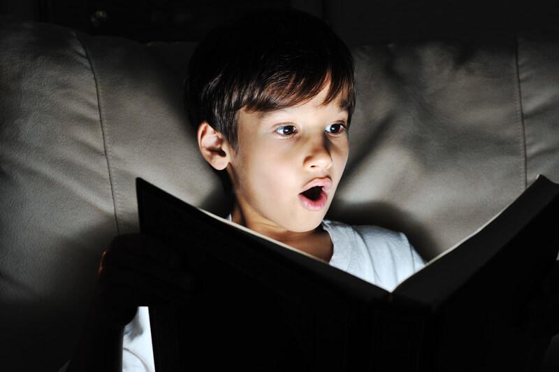 boy is shocked reading math book