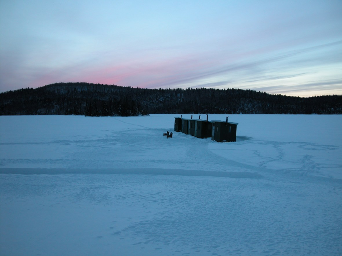 fishing sheds on a frozen lake in the Laurentides Natural Park outside of Montreal, Canada