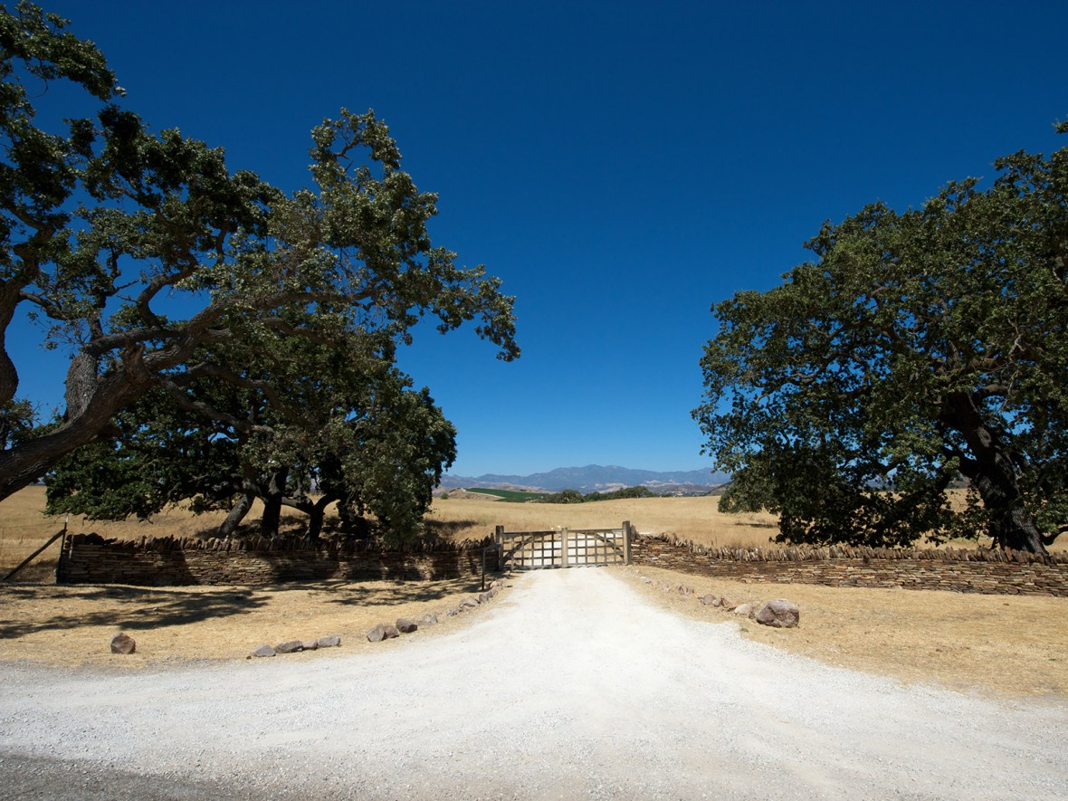 a wooden gate in the Santa Barbara countryside, outside of Los Angeles, California, USA