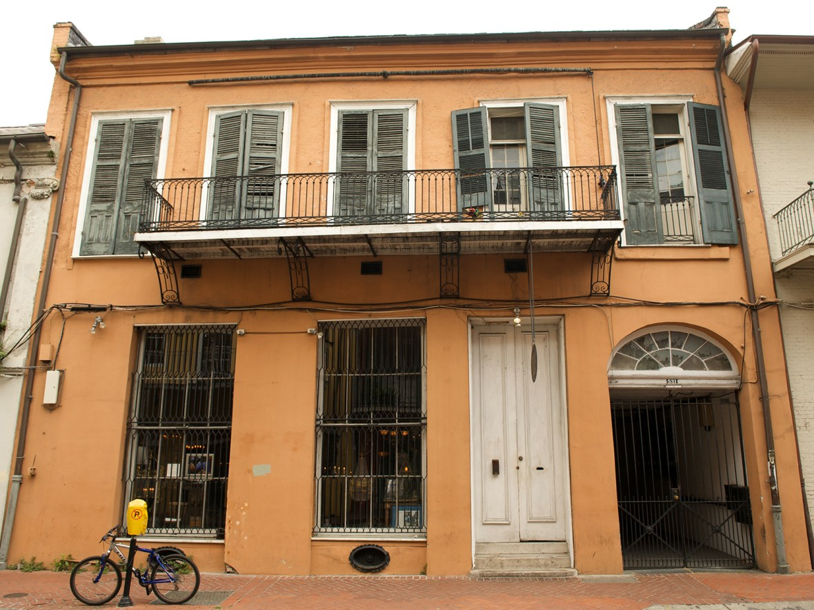 an orange house in the French Quarter, New Orleans, Louisiana, USA