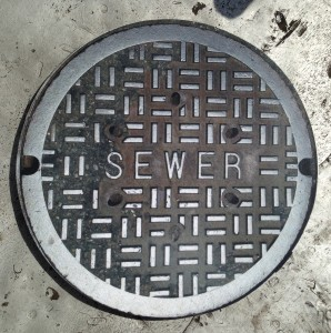 Figure 1: My Friend, Lloyd Wander, Made a Good Business Out of Fixing Manhole Cover Problems.