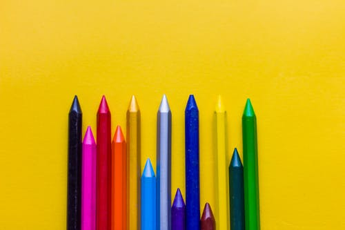 Coloring pencils on a yellow background