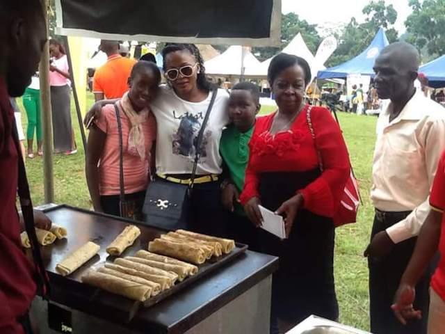 Minister Mutagamba at a rolex stall.