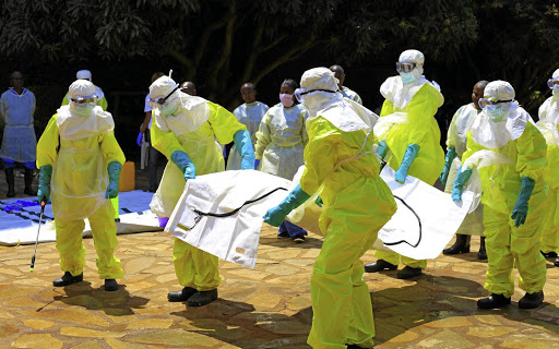 Congolese officials and the World Health Organization officials wear protective suits as they participate in a training against the Ebola virus near the town of Beni in North Kivu province of the Democratic Republic of Congo, August 11, 2018. REUTERS/Samuel Mambo