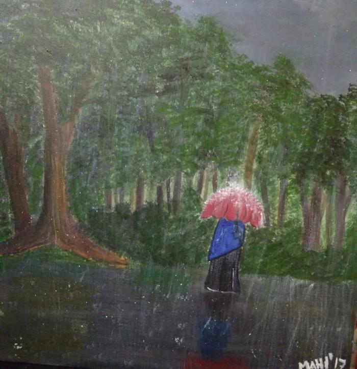 hijabi women holding an umbrella in rain