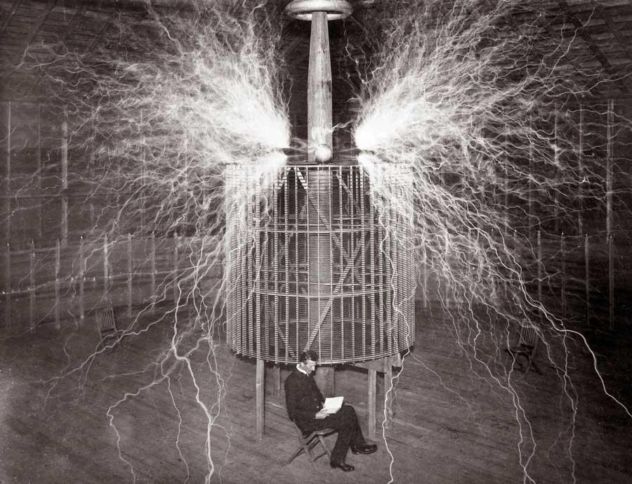 Nikola Tesla reads in his remote Colorado Springs laboratory