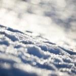雪と反射する光