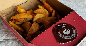 Potato wedges and BBQ sauce