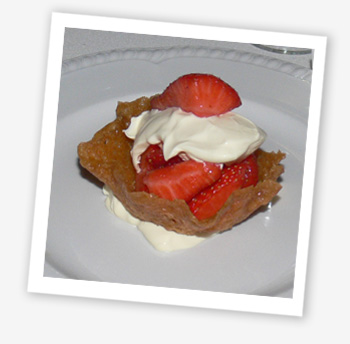 Brandy snap basket with strawberries and clotted cream