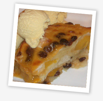 Home-made peach bread and butter pudding with Baileys and Tia Maria