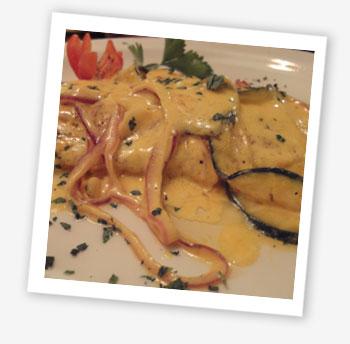 Seabass fillet sautéed in white wine with creamy saffron sauce
