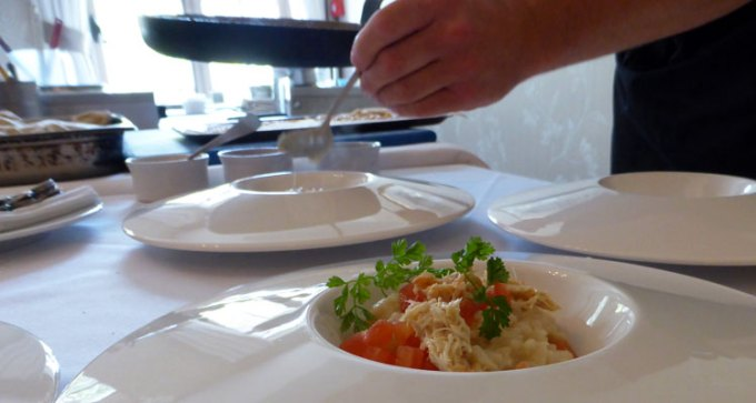 Sous chef Jon-Paul Charlo demonstrates seafood risotto