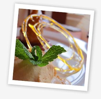 Poached summer pear in white wine lemon and vanilla, vanilla sable, homemade caramel ice cream
