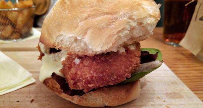 Salmon burger with lime and coriander crème fraiche