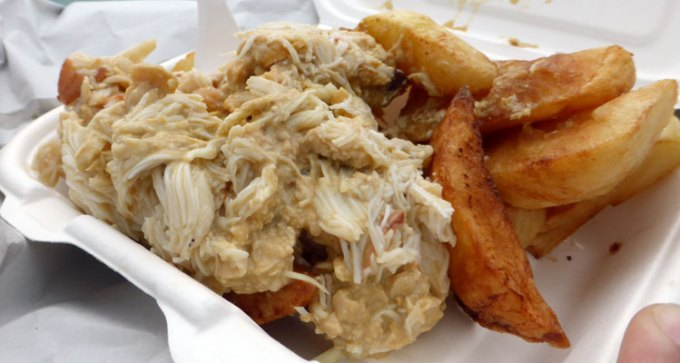Crab on chips! The Island's 'National Dish'!