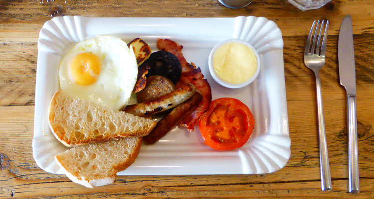 Matt's second breakfast: eggs and bacon, plus black pudding and halloumi.
