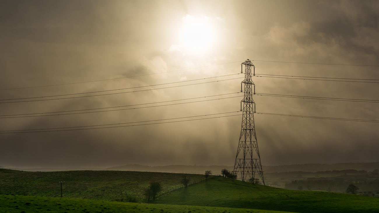 Power lines cross a field in the Black Country