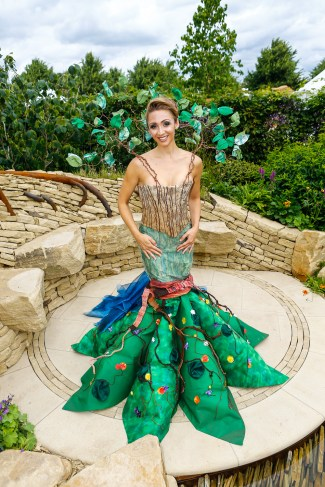 TV Actress Lucy-Jo Hudson wearing a dress designed by students from the Universitary of Hudderfield. Zoflora sponsored show garden at RHS Hampton Court Palace Flower Show 2016 entitled Outstanding Natural Beauty. Designed by Helen Elks-Smith.