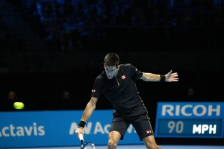 Novak Djokovic digs out a return.
