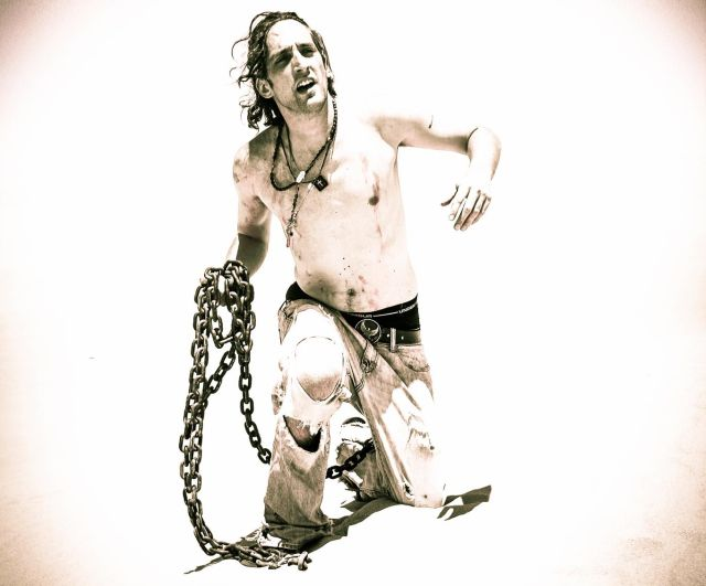 Mike Cavallo carrying the chains of addiction for an album photoshoot